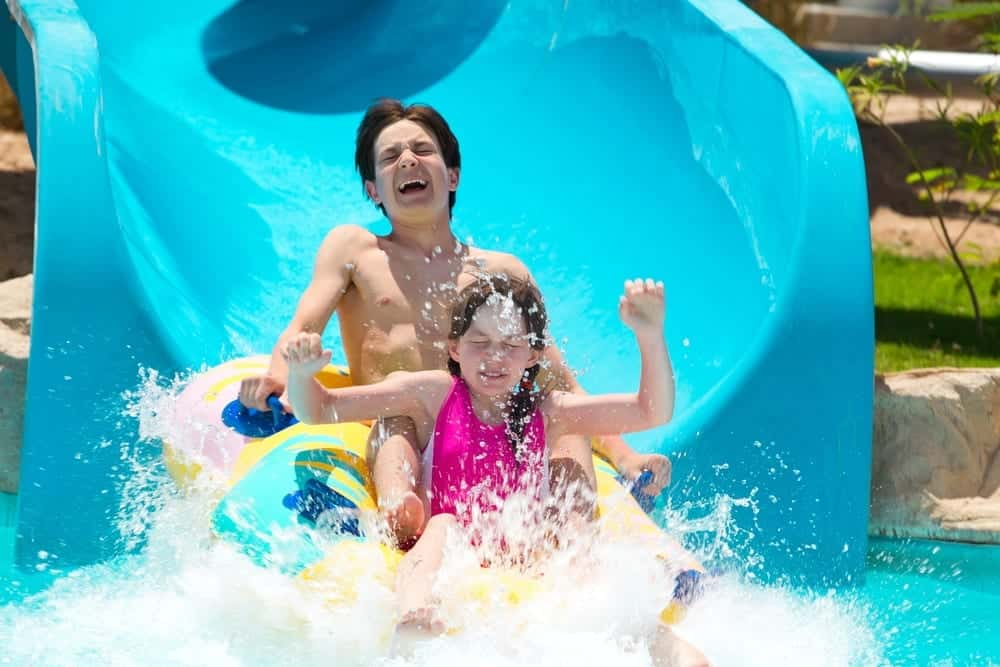 family enjoying a water slide at Dollywood's Splash Country