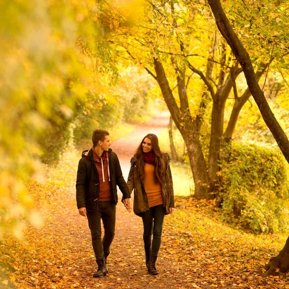 Couple walking together in the fall