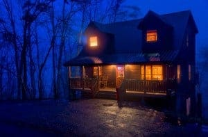 view of secluded Pigeon Forge cabin at night