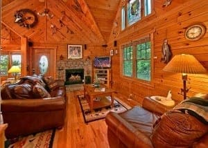 The charming living room in one of our secluded Gatlinburg cabins.