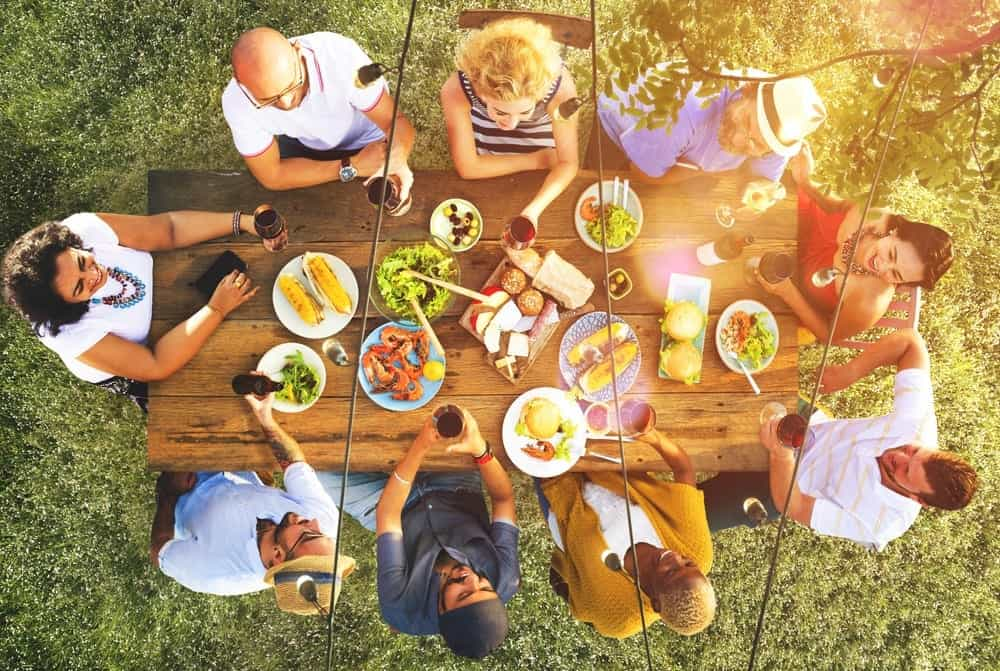 Family eating outside at a picnic table