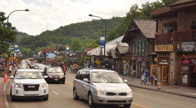 Cars driving down the Parkway in downtown Gatlinburg.