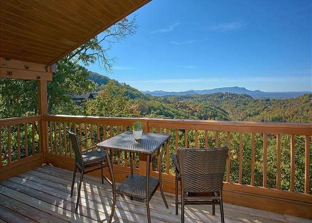 Beautiful mountain views from the deck of the Morning View honeymoon cabin.